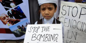 A Bangladeshi child protests against Israeli attack on Gaza in Dhaka, Bangladesh, Saturday, July 12, 2014. (AP Photo/A.M. Ahad)