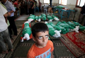 Funeral ceremony is held for Palestinian Abu Jamei family members, who died after an Israeli aircraft hit their house, in Khan Yunis, Gaza on July 21, 2014.