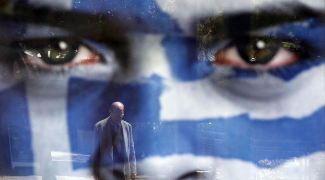 LaPresse05-05-2012PoliticaGrecia, domani si svolgeranno le elezioni politicheA pedestrian is reflected on an election poster of Democratic Alliance party at a bus stop in Athens, Saturday May 5 2012. Greeks head to the polls Sunday in their most critical and uncertain  election in decades, with voters set to punish the two main parties that are being held responsible for the country's dire economic straits.