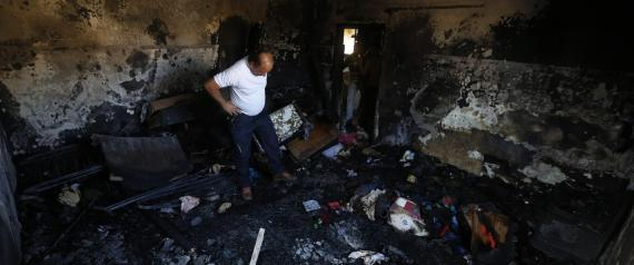 epa04867168 A Palestinian man checks the fire damage to a relative's house in the  West Bank village of Douma near Nablus City, 31 July 2015. A Palestinian infant was killed and several people injured when their home was set alight in the northern West Bank early 31 July 2015, an official said. A group of masked people believed to be Israeli settlers threw flammable bombs into two houses on the outskirts of the village of Doma, south of Nablus, said Ghassan Daghlas, a Palestinian Authority official.  EPA/ALAA BADARNEH