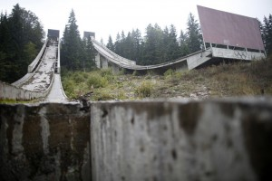 A view of the disused ski jump from the Sarajevo 1984 Winter Olympics on Mount Igman, near Sarajevo September 19, 2013. Abandoned and left to crumble into oblivion, most of the 1984 Winter Olympic venues in Bosnia's capital Sarajevo have been reduced to rubble by neglect as much as the 1990s conflict that tore apart the former Yugoslavia. The bobsleigh and luge track at Mount Trebevic, the Mount Igman ski jumping course and accompanying objects are now decomposing into obscurity. The bobsleigh and luge track, which was also used for World Cup competitions after the Olympics, became a Bosnian-Serb artillery stronghold during the war and is nowadays a target of frequent vandalism. The clock is now ticking towards the 2014 Winter Olympics, with October 29 marking 100 days to the opening of the Games in the Russian city of Sochi. Picture taken on September 19, 2013. REUTERS/Dado Ruvic (BOSNIA AND HERZEGOVINA - Tags: SOCIETY SPORT OLYMPICS SKIING)