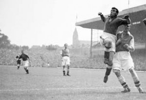 Everton's Dixie Dean (second r) climbs high as the ball is crossed into the box